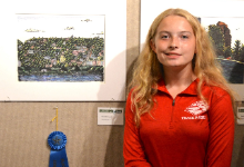 New Richmond High School sophomore Ellie Arkus is pictured from earlier this year with her winning entry in the Plein Air Art Show.