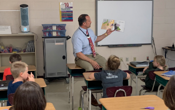 Teacher reading to students.