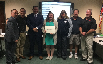 Emma Haussler was honored Oct 21 by the New Richmond Board of Education and presented with the Leading Lion Award.