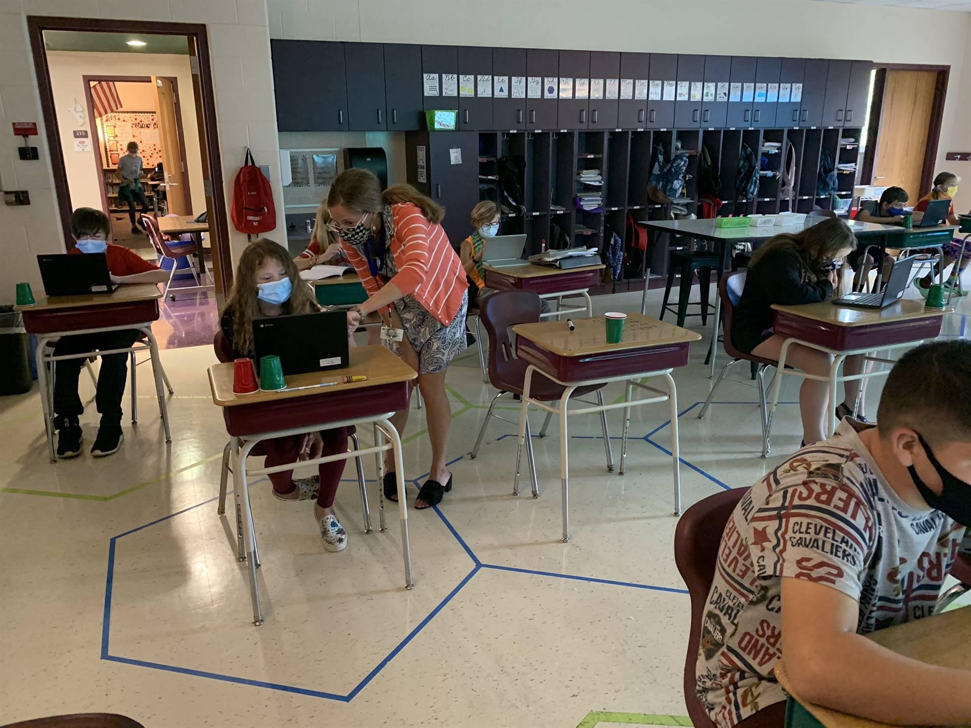 Teacher helping student
