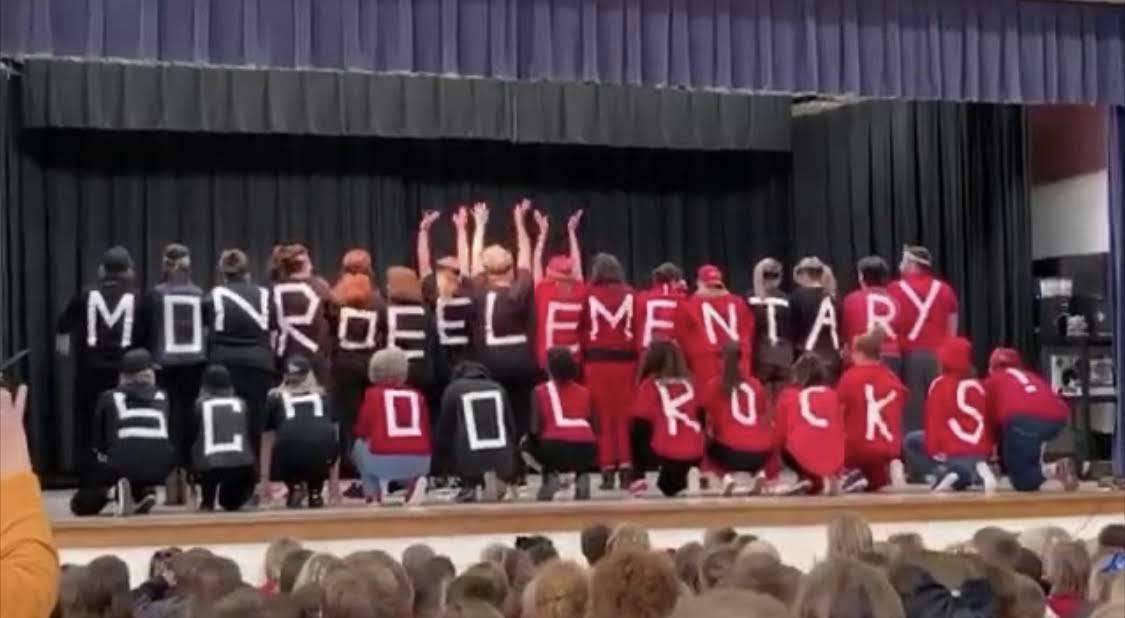 Teachers display signs school rocks