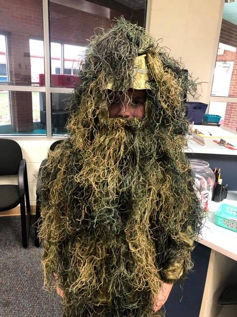 Moss covered person
