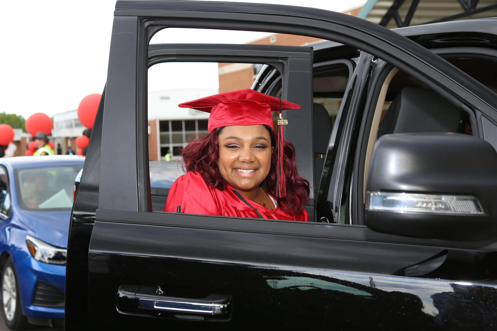 Graduate framed in truck window