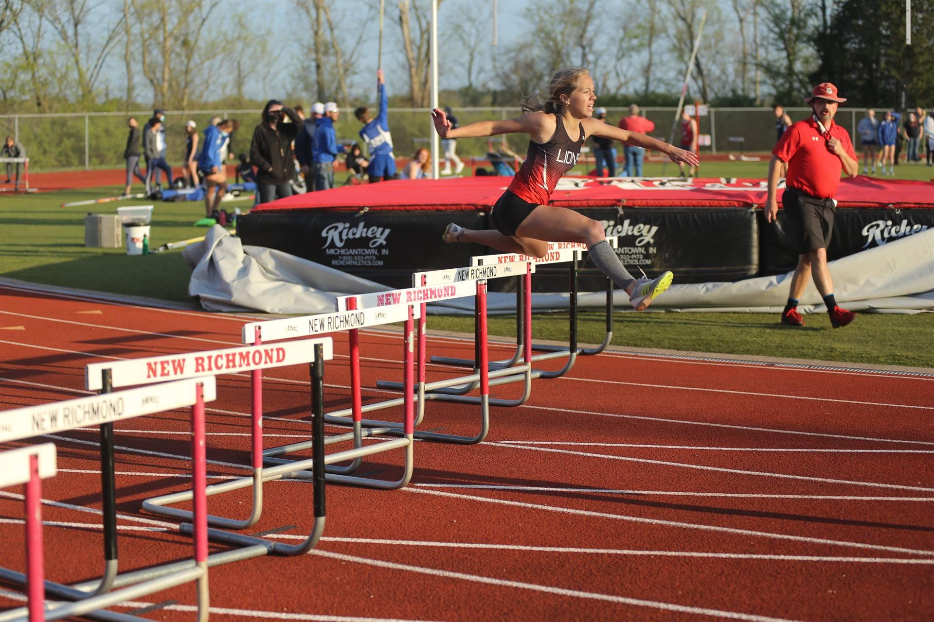 hurdles track jumper