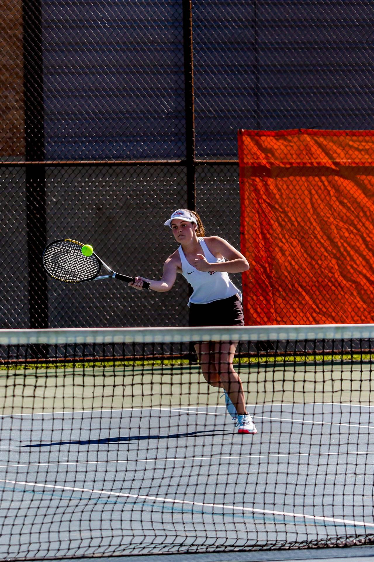 tennis player ball