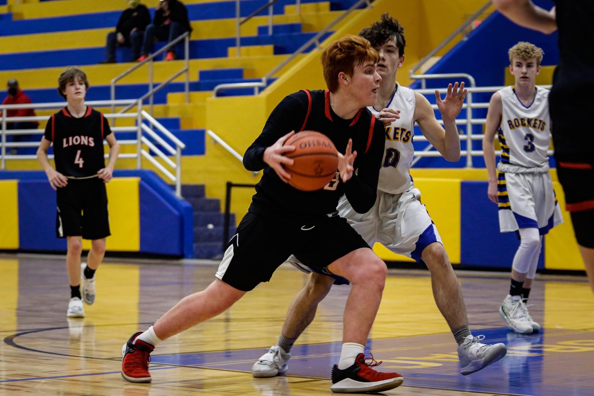 boys basketball player with ball
