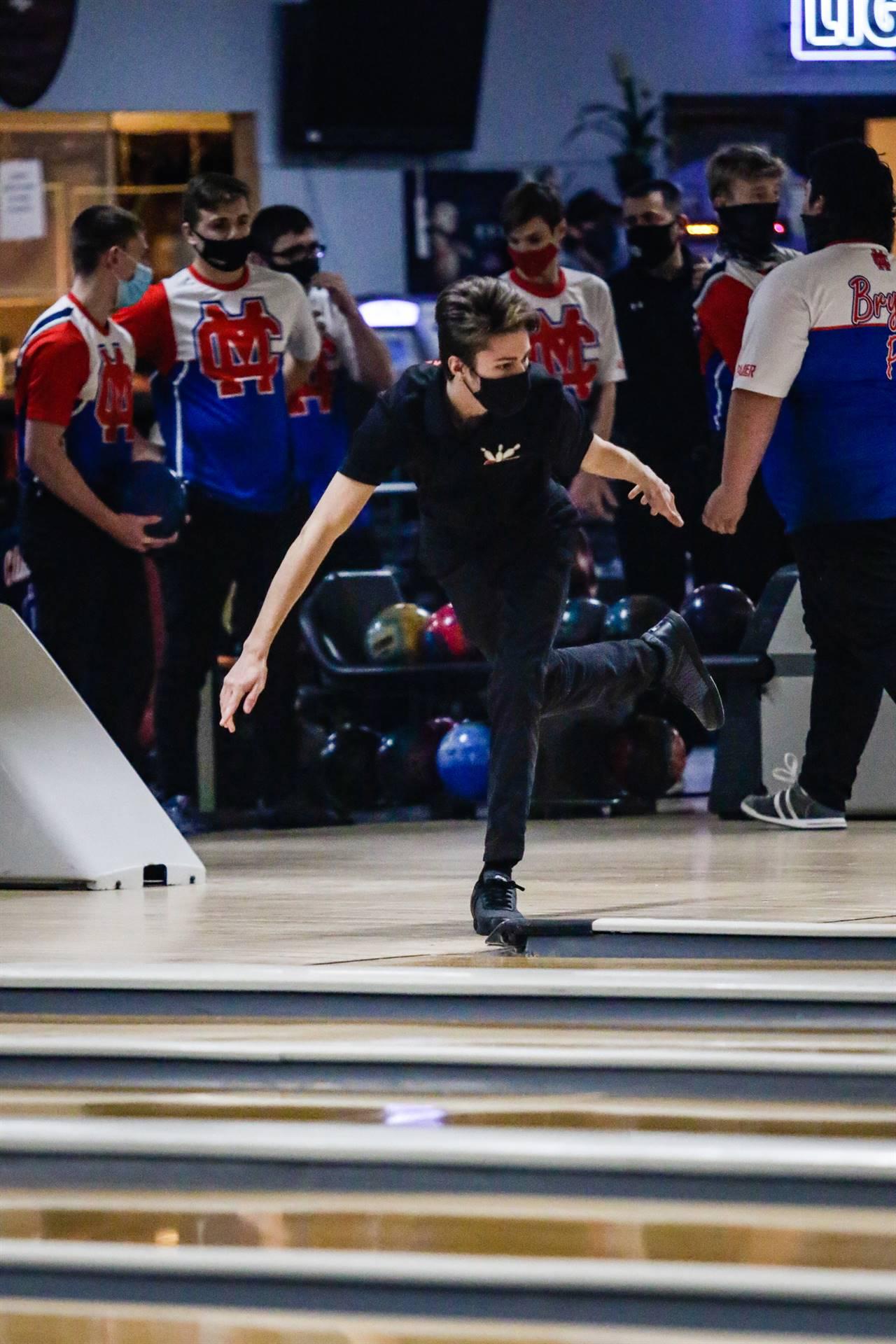 bowler releasing ball