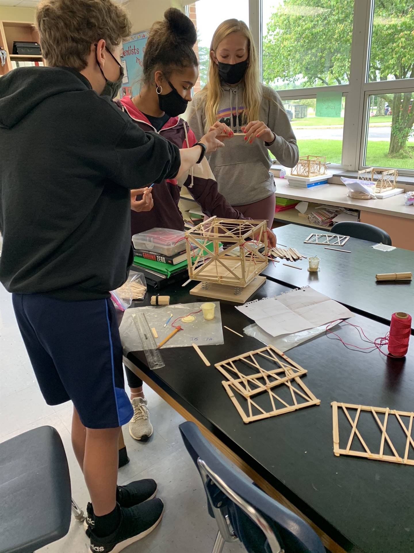 Middle School students building structures for earthquake experiment