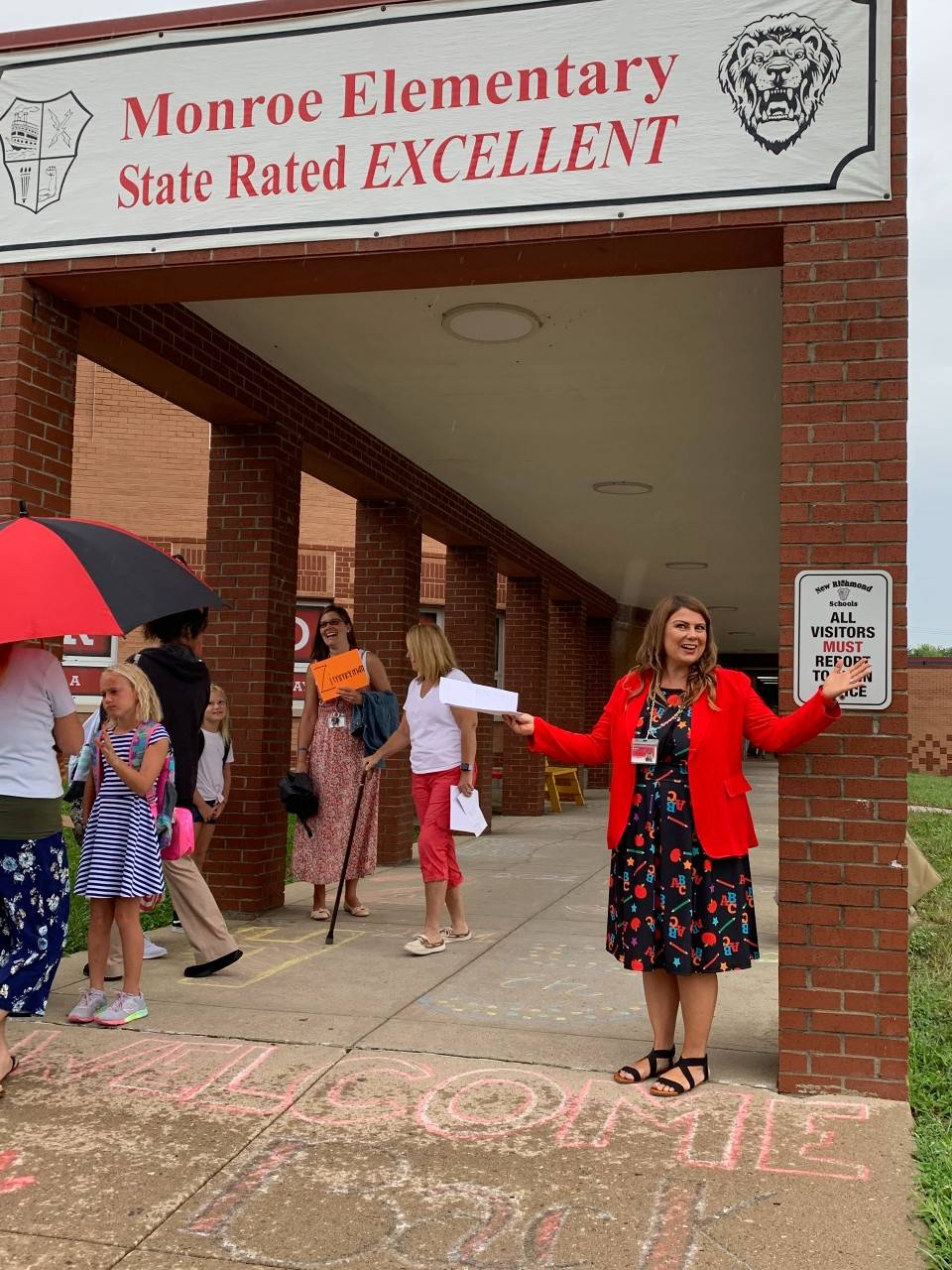 Dr Kunz greeting students back to school