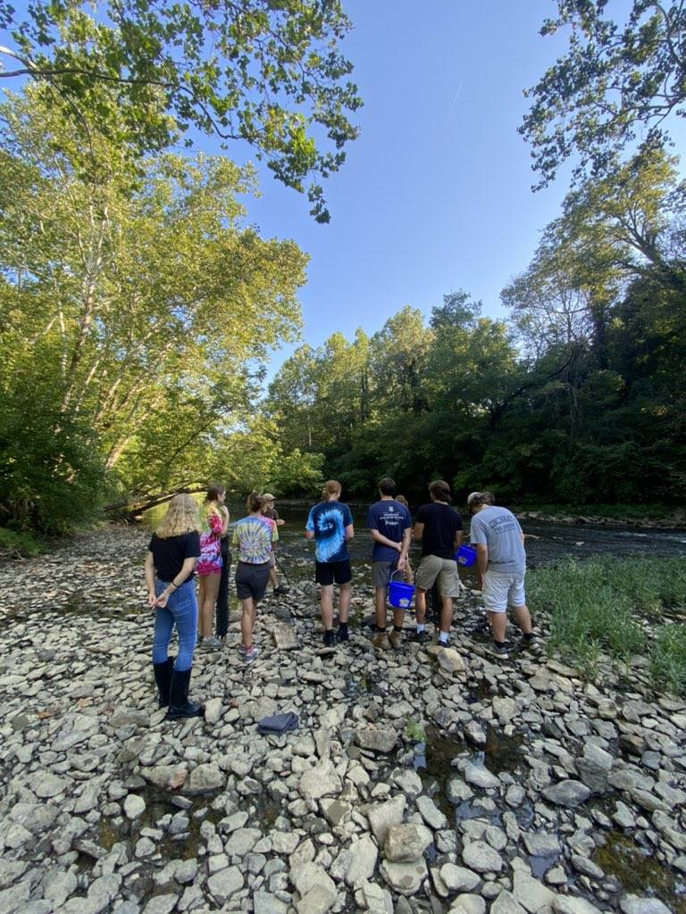 Outdoor science lessons at stream