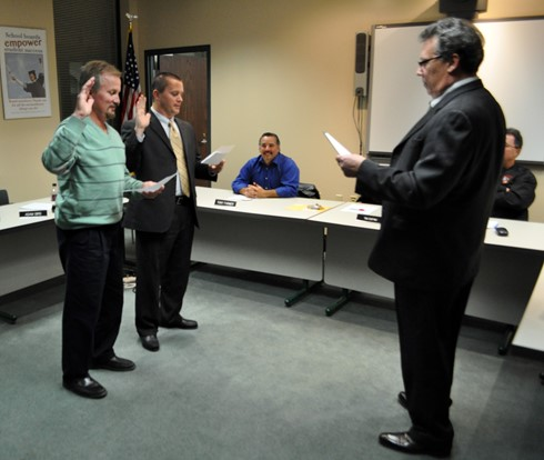 Board members take oath of office